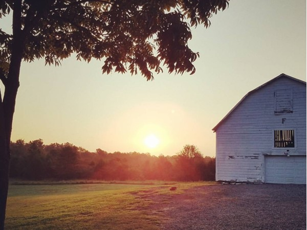 Sunrise over an old barn still in use off of highway 267 in Searcy