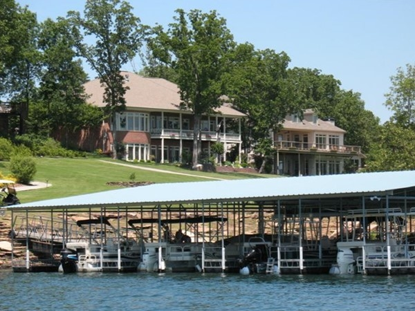 Community dock and residences in prestigious lakefront Eagle Bay Estates