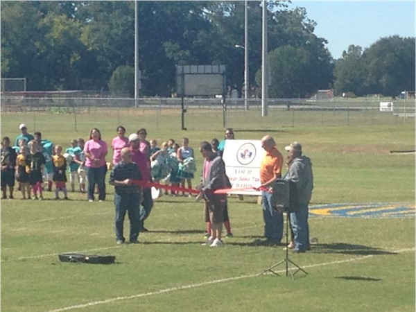 The ribbon cutting ceremony for the reopening of the Pee Wee football fields