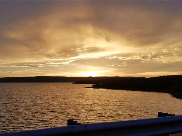 A breathtaking sunset over Greers Ferry Lake off the dyke on Highway 107
