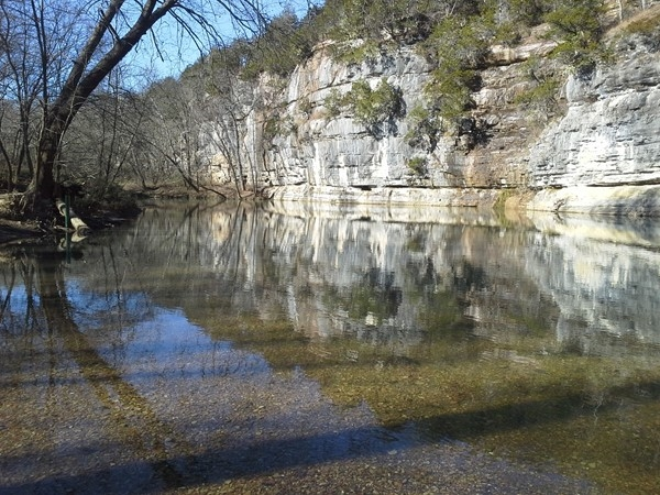 Still waters of the Buffalo River reflecting the beautiful bluffs