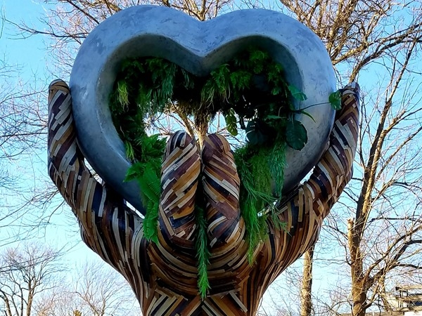 Unique and soulful art, Stone Heart in Wooden Hands sculpture, in located in Lawrence Plaza
